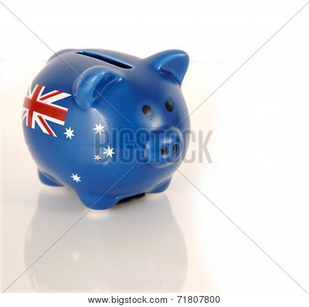 Piggy Bank With Australian Flag On White Reflective Surface.