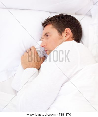Portrait Of A Sad Man Lying In Bed