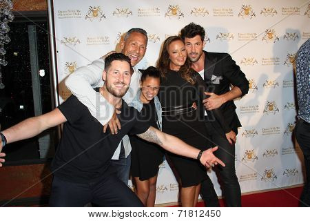 LOS ANGELES - SEP 10:  Valentin Chmerkovskiy, Leah Remini and family, Maksim Chmerkovskiy at the Dance With Me USA Grand Opening at Dance With Me Studio on September 10, 2014 in Sherman Oaks, CA