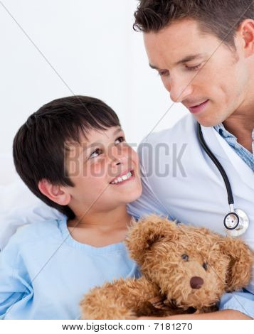 Portrait Of A Smiling Little Boy And His Doctor