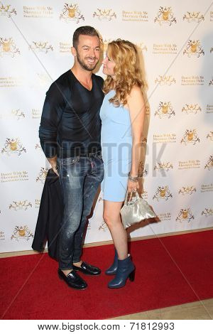 LOS ANGELES - SEP 10:  Artem Chigvintsev, Lea Thompson at the Dance With Me USA Grand Opening at Dance With Me Studio on September 10, 2014 in Sherman Oaks, CA