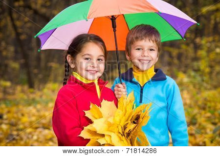 Two kids in autumn forest