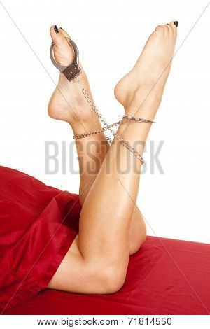 Woman Legs Red Sheet Handcuff On Legs And Toes