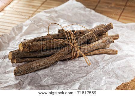 bundled liquorice sticks on wrapping paper
