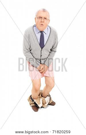 Senior with the pants down holding his crotch isolated on white background