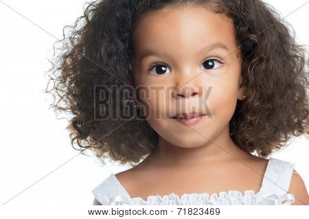 Close-up portrait of a cute small afro american girl with curly hair isolated on white