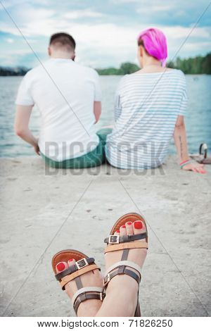 Couple On The Bank Of River