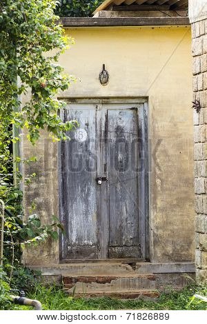 Locked door of an old house at the country side farm