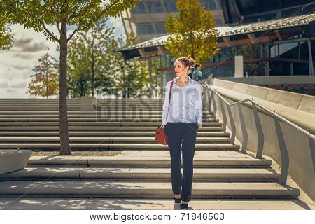 Slender Young Woman Descending Concrete Stairs