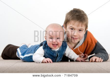Crawling Baby Girl And Her Brother