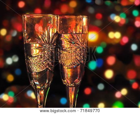 Two Glasses With Champagne Against Festive Background