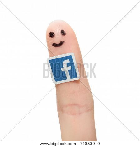 Facebook Logo Printed On Paper And Stuck To The Finger.