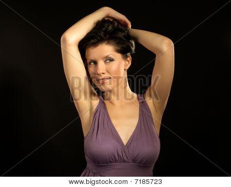 Beautiful Woman Wearing Lilac Dress And Dancing