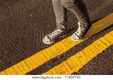 walking on yellow street lines