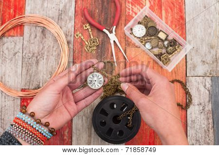 making craft jewellery on wood background