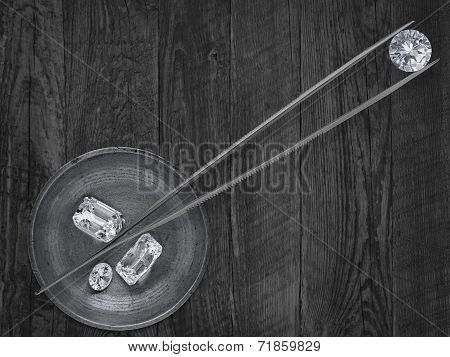 Diamonds In A Working Tray And Tweezers