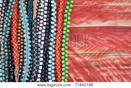 colourful bead bracelets grungy wood background