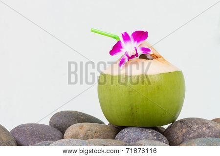 Serving coconut water on pebble stone
