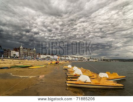 Clouds build up over the Dorset coastal town of Weymouth