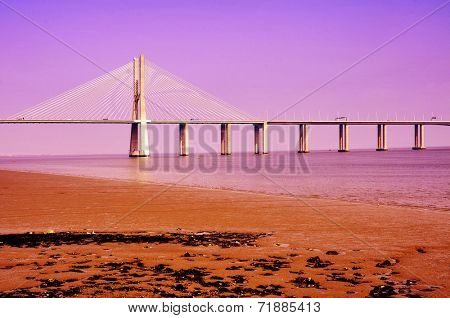 LISBON, PORTUGAL - MARCH 20: View of Vasco da Gama Bridge on March 20, 2014 in Lisbon, Portugal. This viaduct over the Tagus River is the longest bridge in Europe