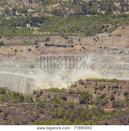 A cloud forms over an Cyprus asbestos mine after an explosion