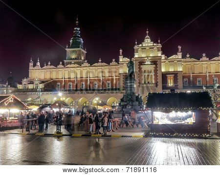 KRAKOW, POLAND - DECEMBER 19 2013: Annual christmas fair with seasonal stands organized during christmas time on the Main Market Square in Krakow, Poland