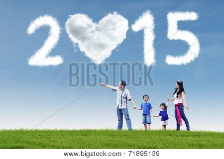 Happy Family In Field Under Cloud Of 2015