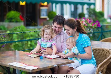 Family At An Outside Cafe