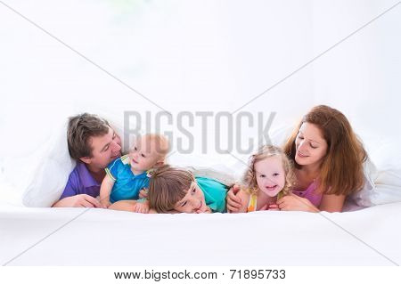 Happy Big Family In The Bedroom