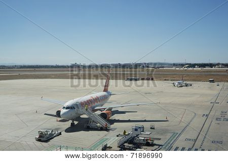 VALENCIA, SPAIN - SEPT 11, 2014: An EasyJet airliner at the Valencia Airport. EasyJet is a British airline carrier that is the largest airline of the UK based on the number of passengers carried.