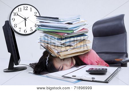 Tired Woman With A Pile Of Document