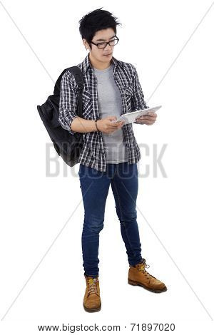 Trendy Student Holding Digital Tablet