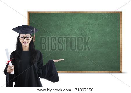 Young Graduate Showing Empty Board 1