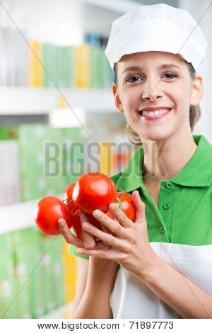 Sales Clerk With Fresh Tomatoes