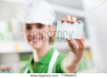 Sales Clerk Holding A Blank Business Card