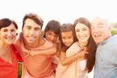 picture of grandparent child  - Parents With Grandparents Giving Children Piggyback Ride - JPG