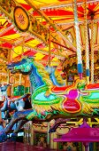picture of carousel horse  - View of Carousel with horses on a carnival Merry Go Round - JPG