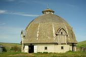 pic of dairy barn  - Horizontal photo of a historic Old round barn on farm