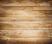pic of log fence  - Background of brown old natural wood planks Dark aged empty rural room with tree floor pattern texture Closeup gold view surface of retro pine red logs inside vintage light warm interior with shadows - JPG