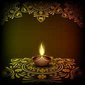 pic of rangoli  - Illuminated oil lit lamp on beautiful floral design decorated rangoli for Hindu community festival Happy Diwali celebrations - JPG