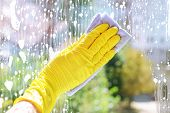 pic of window washing  - Cleaning windows with special rag  - JPG