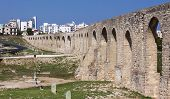 stock photo of larnaca  - An ancient aqueduct still stands on the outskirts of Larnaca - JPG