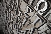 image of scribes  - Metalic Greek lettering stands proud on a stone monument - JPG