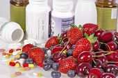 picture of pesticide  - Berries vitamins and nutritional supplements on white background - JPG