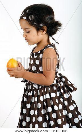 toddler eating mango