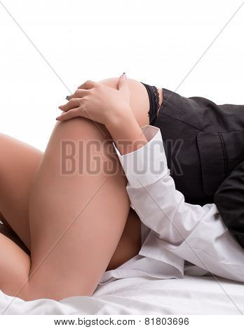 Girl's hand on her girlfriend's thigh