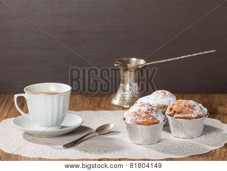 Cup Of Coffee With Tasty Muffins And Turk For Coffee