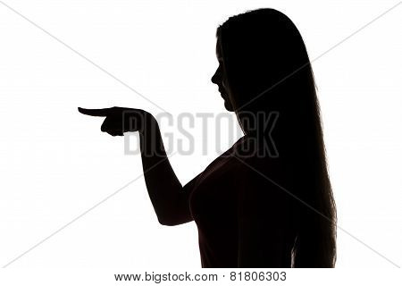 Silhouette of teenage girl showing something