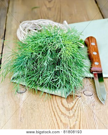 Dill green with knife and napkin on board