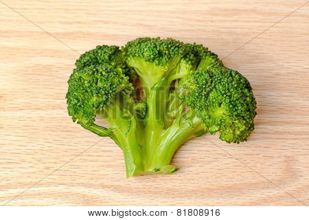 Broccoli on a plank of wood